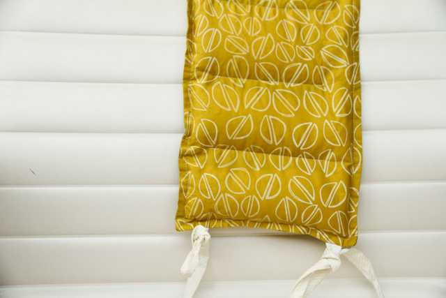 citron hot-cold rice pack over chari back with white ties by Lovely and Enough