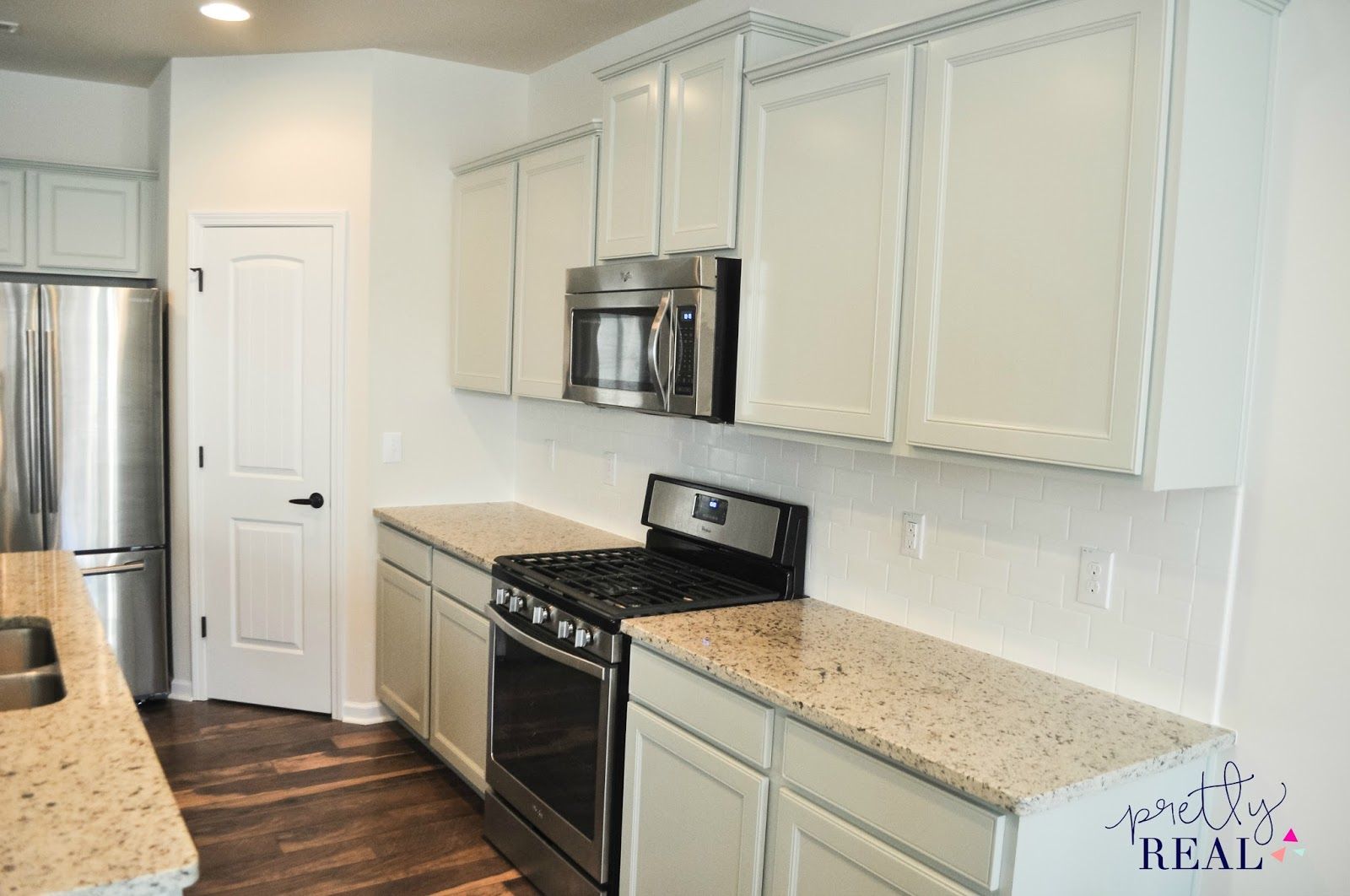 repainting kitchen cabinets grill we painted our brand new and here s how it turned