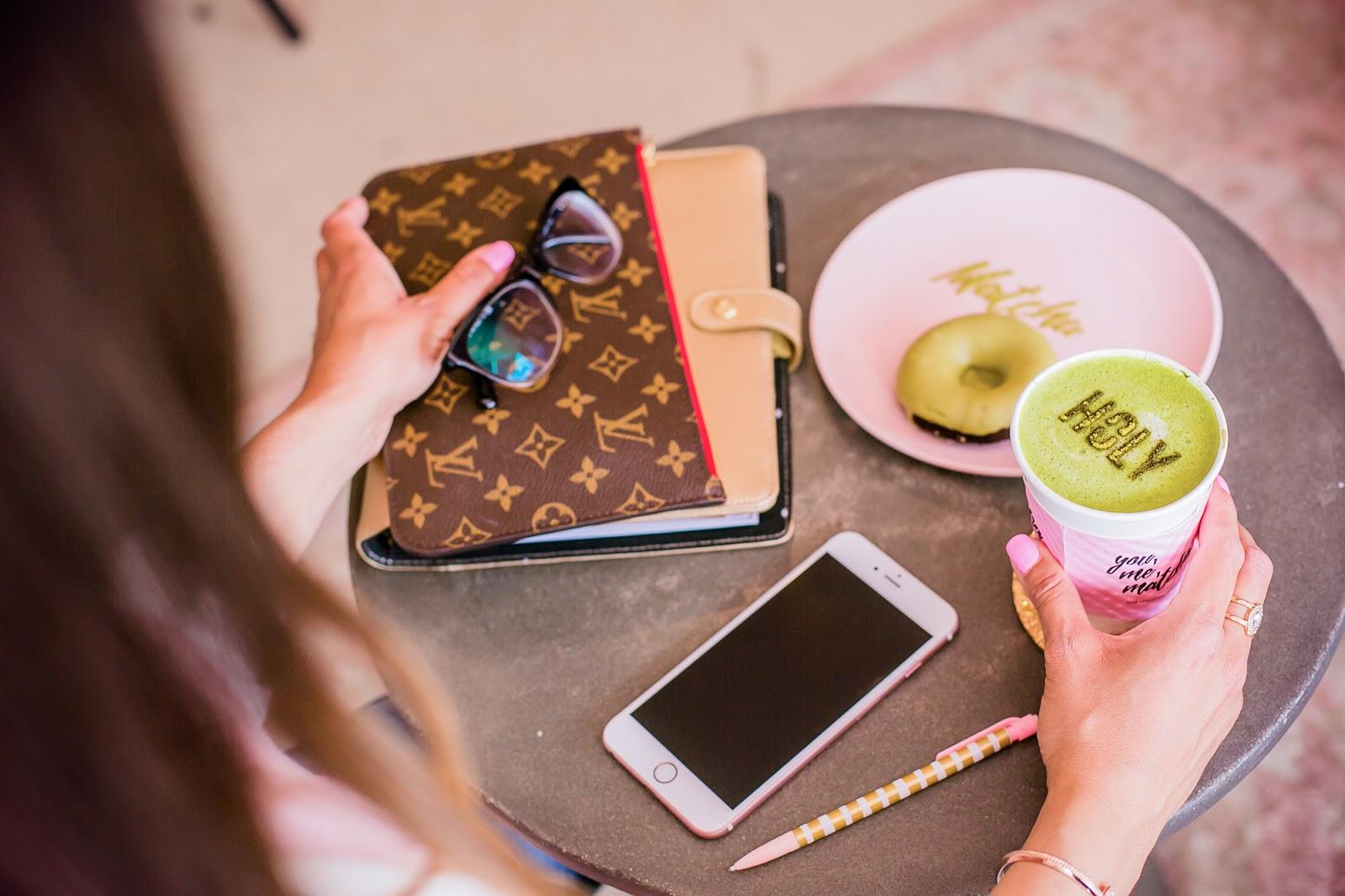 Louis Vuitton clutch, Chanel eyeglasses