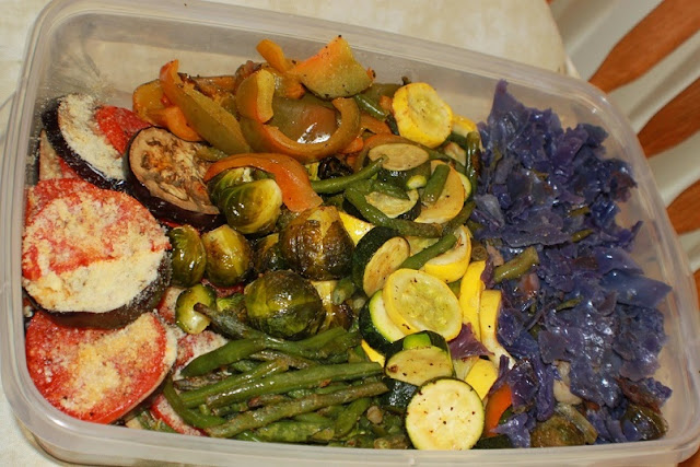 this is a photo of roasted vegetables. This is an easy recipe showing how to make roasted vegetables. After baked they are in a colorful basket in a white plate and green towel to look pretty on the table. These roasted vegetables and a healthy addition to any Keto Diet or for those watching their weight and caloric intake