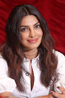 Priyanka Chopra in White Shirt and Colorful Skirt at Baywatch Press Conference  15th May 2017 ~  Exclusive 08.jpg