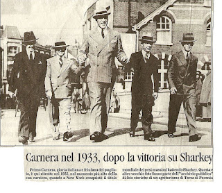 Primo Carnera, who stood 6ft 6ins tall, towered above the average man of his day, as this news cutting shows