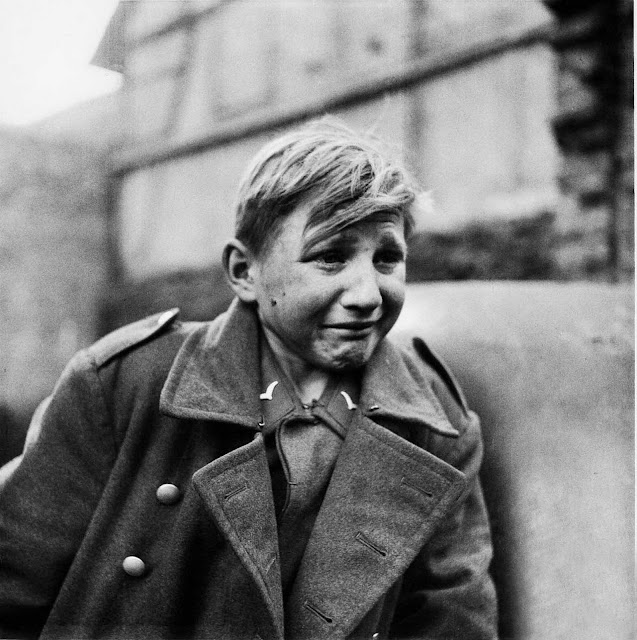 A fifteen year old German soldier, Hans-Georg Henke, cries being captured by the US 9th Army in Germany on April 3, 1945