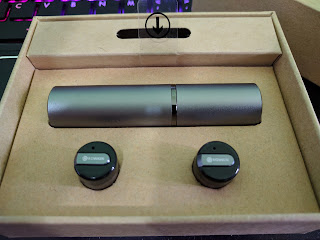 The 2 Rowkin Bit Stereo earbuds, and the charging case, in the box