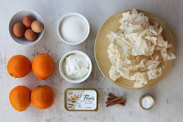 Υλικά της συνταγής για Πορτοκαλόπιτα με ολόκληρα πορτοκάλια