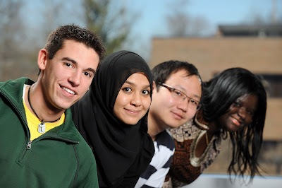 4 young people - 2 men, 2 women from different cultural backgrounds