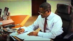 Dangote working in office