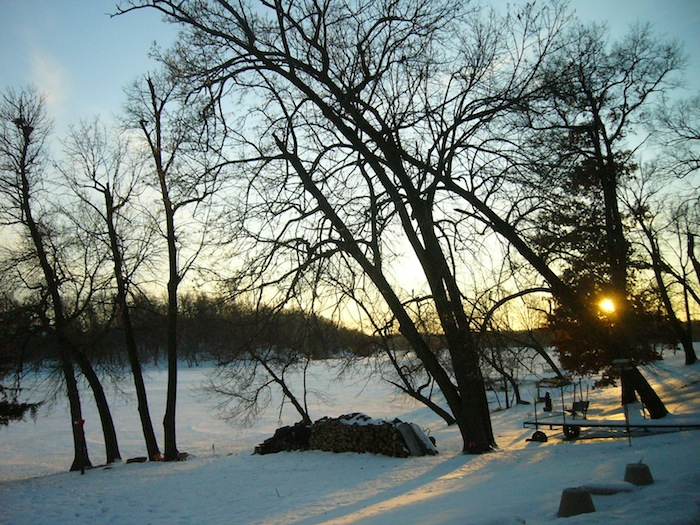 enjoying homemade beef stew while watching early sunset on frozen minnesota lake