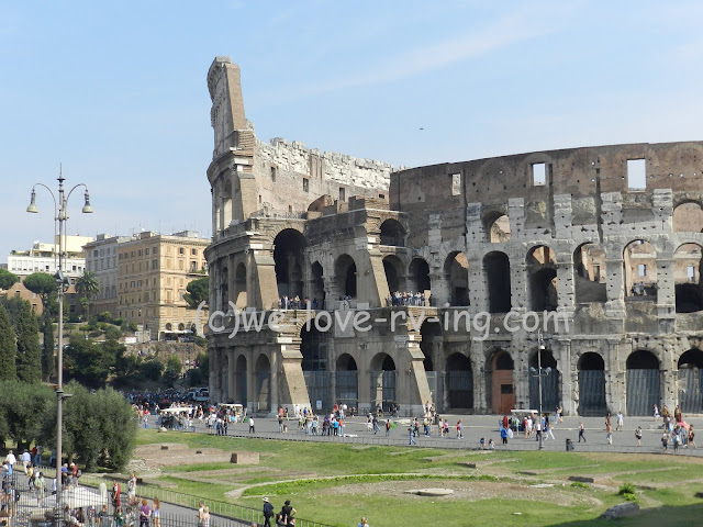 This shows a different view of the Colosseum from the Arc di Constantine