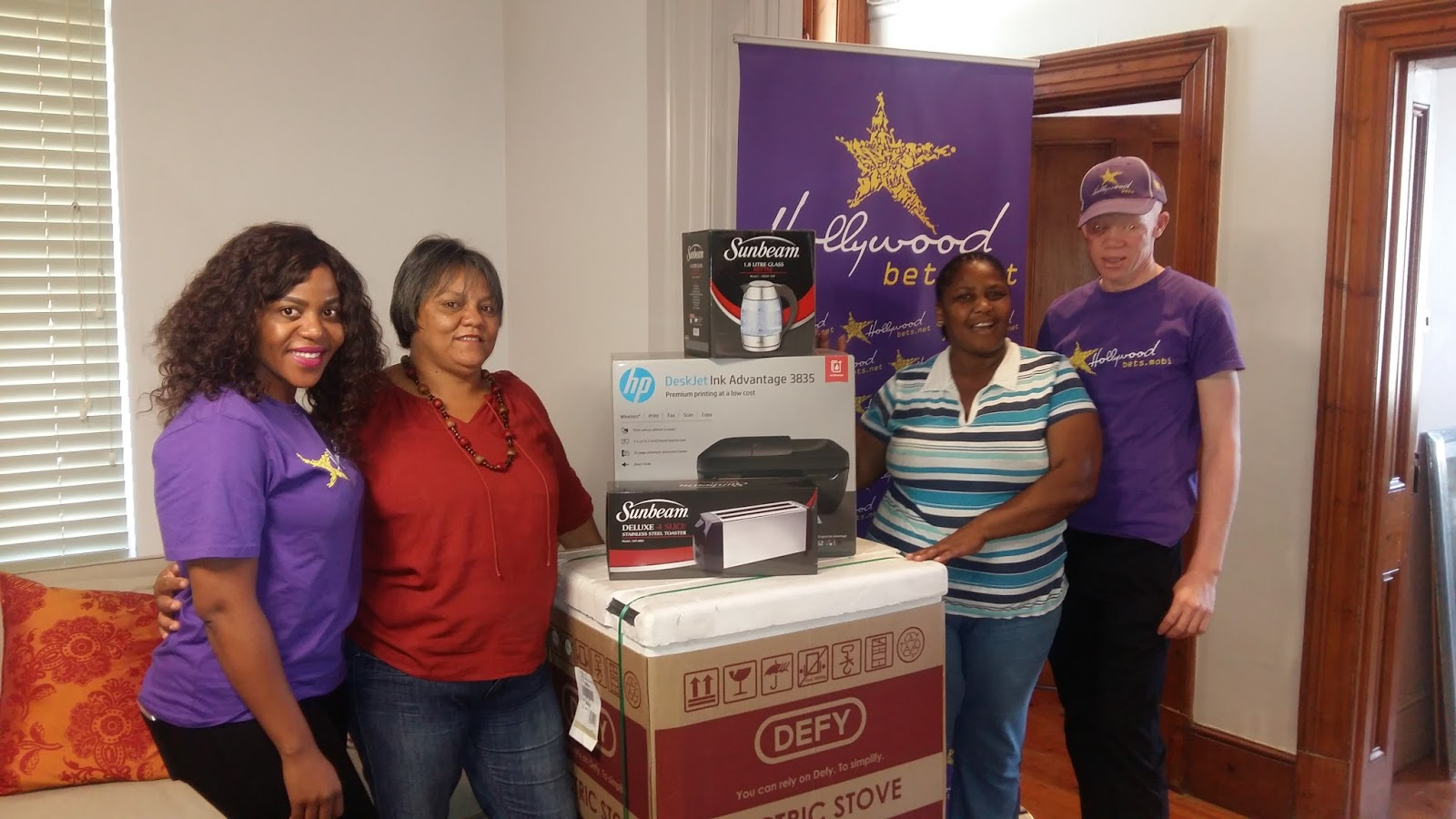 Staff at the Rape Crisis Cape Town Trust are thankful for a new stove and fridge donated by Hollywoodbets Langa