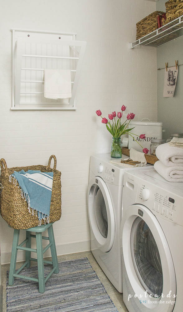 small laundry room makeover with white brick wallpaper
