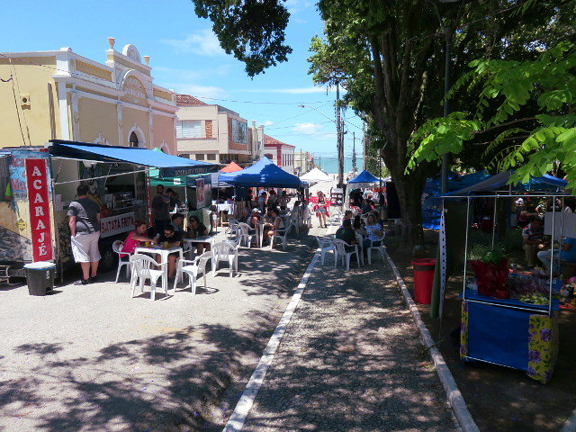 Food trucks parked around the square where Feira da Freguesia happens.