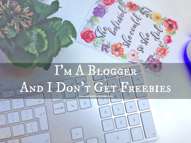 I'm a blogger and I don't get freebies header image for blog post keyboard floral quote sign and plant