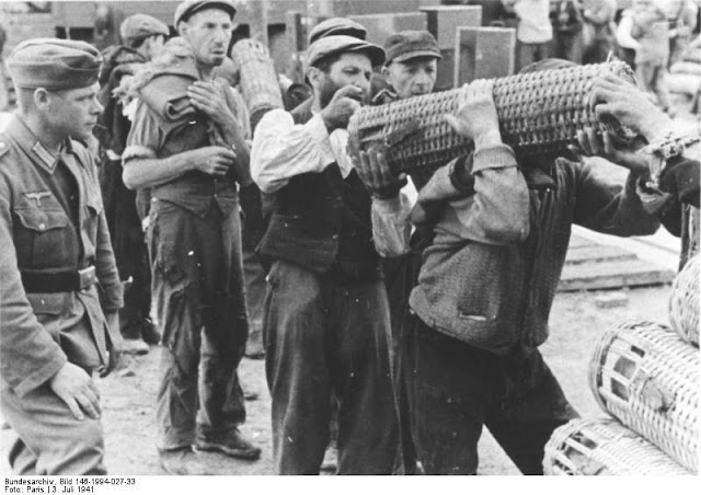 Jewish forced laborers unloading German ammunition at Isbica railway station 3 July 1941 worldwartwo.filminspector.com