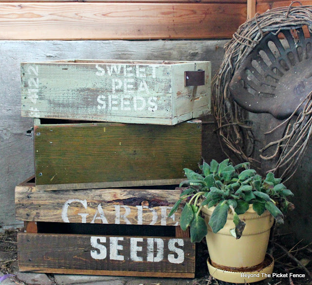 use reclaimed wood crates in the garden to hold plants