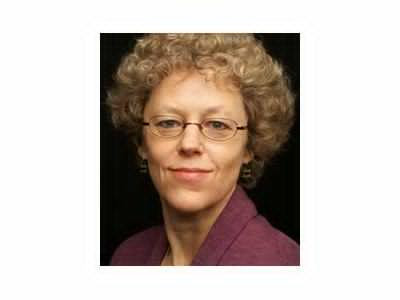 Author Leslie Kean - caucasion curly haired mid 40s circular glasses
