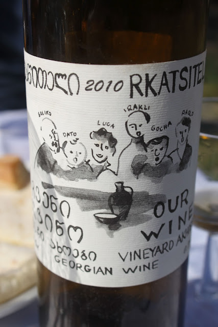 Hand drawn label with portraits of the makers of Our Wine.