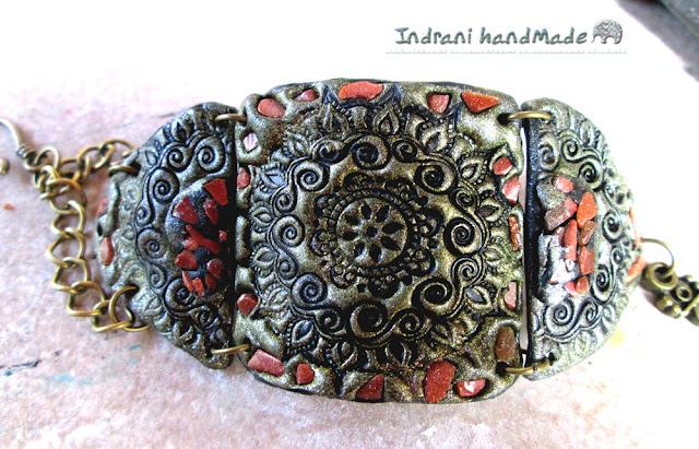http://www.crafty.ro/produse/213282-bratara-cu-spirale-si-cipsuri-din-piatra-soarelui