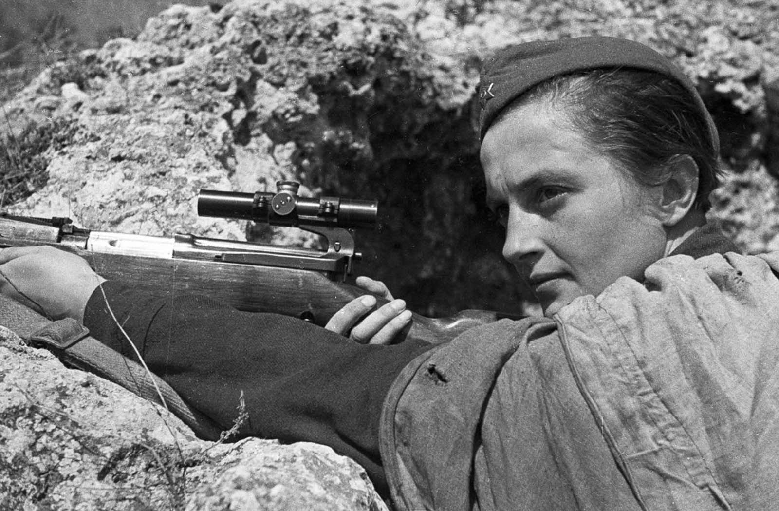 Lyudmila Pavlichenko in combat at Sevastopol. With 309 confirmed kills, she is one the deadliest snipers in history. June, 1942.