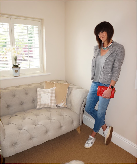 My Midlife Fashion, Zara statement necklace, grey V neck marl t shirt, grey knitted boucle jacket , apple watch, leather quilted cross body bag, zara cigarette length jeans, golden goose trainers