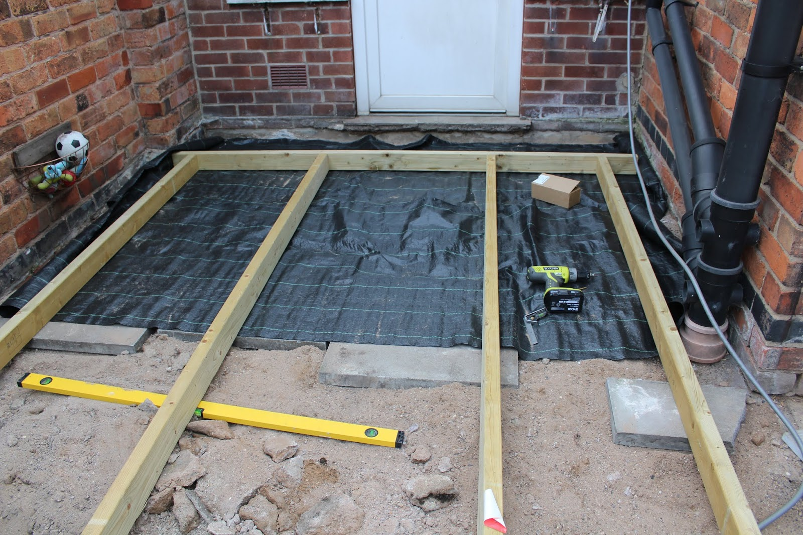 Laying Landscaping Fabric Underneath Decking
