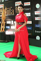 Apoorva in a Stunning Tight Leg Split Sleeveless Red Gown at IIFA Utsavam Awards 61.JPG