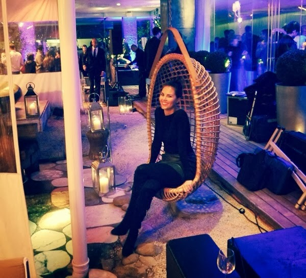 Swinging chair at the PPQ London Fashion Week afterparty at the Sanderson hotel courtyard