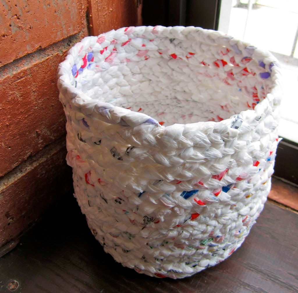 http://www.instructables.com/id/Make-a-basket-out-of-plastic-bags/