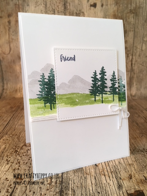 This picture shows a handmade card with a forest and mountain scene, made with the Waterfront stamp set by Stampin' Up! and Tranquil Tide and Lemon Lime Twist ink, also by Stampin' Up!