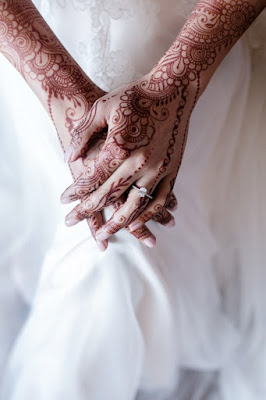 wedding henna hands and engagement ring photo