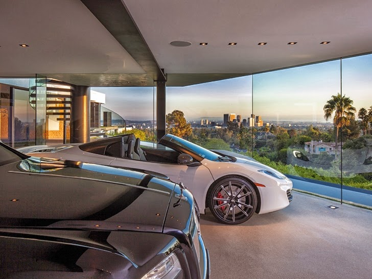 Cars in the garage in Perfect modern mansion in Beverly Hills