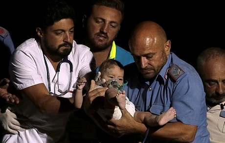 Watch the extraordinary moment a seven-month-old baby is pulled out alive and unharmed from the rubble after earthquake hit Italy