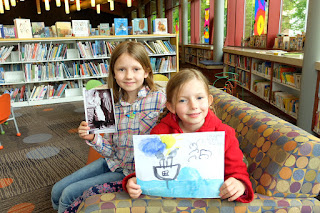 Essay winners Alyssa and Laura at Olney Library