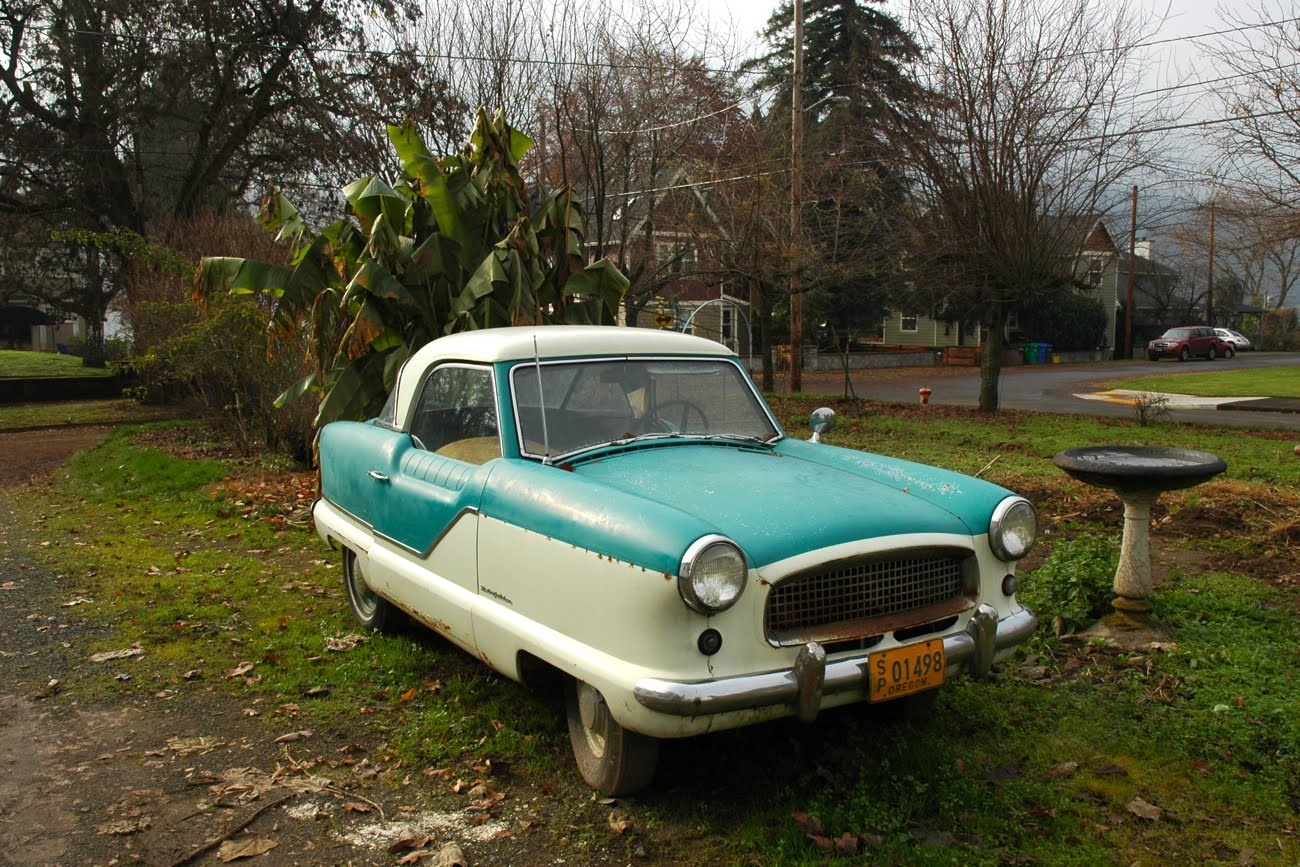 OLD PARKED CARS.: 1957 Nash Metropolitan
