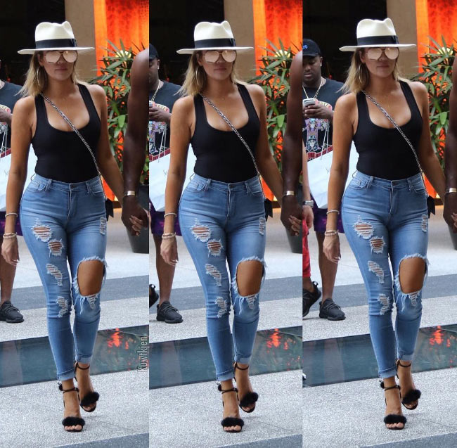 Khloe Kardashian and her sexy high-waist ripped jeans though (photos)
