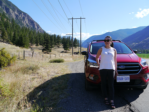 Driving through the Similkameen Valley, BC, in a cherry red Ford Escape