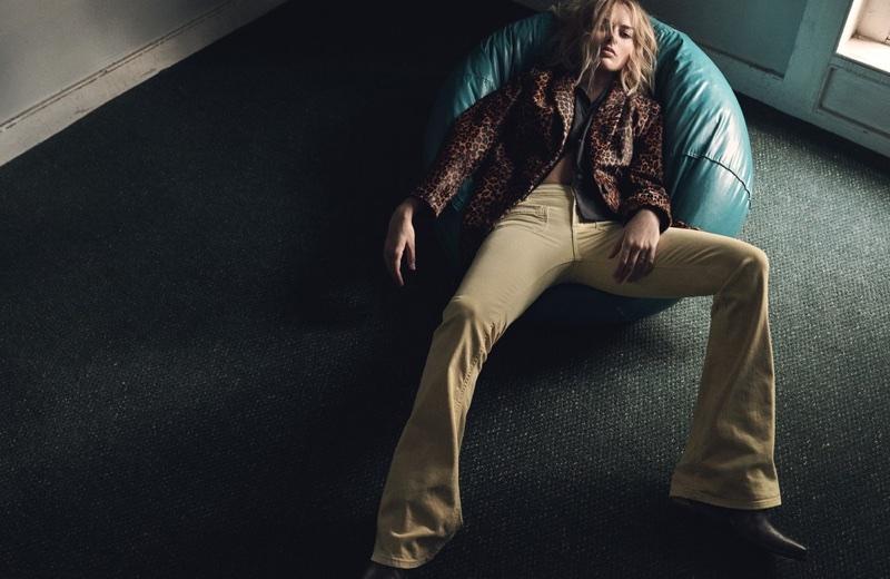 Margot Robbie wears Dondup coat and pants, Acne Studios shirt and Golden Goose Deluxe Brand boots