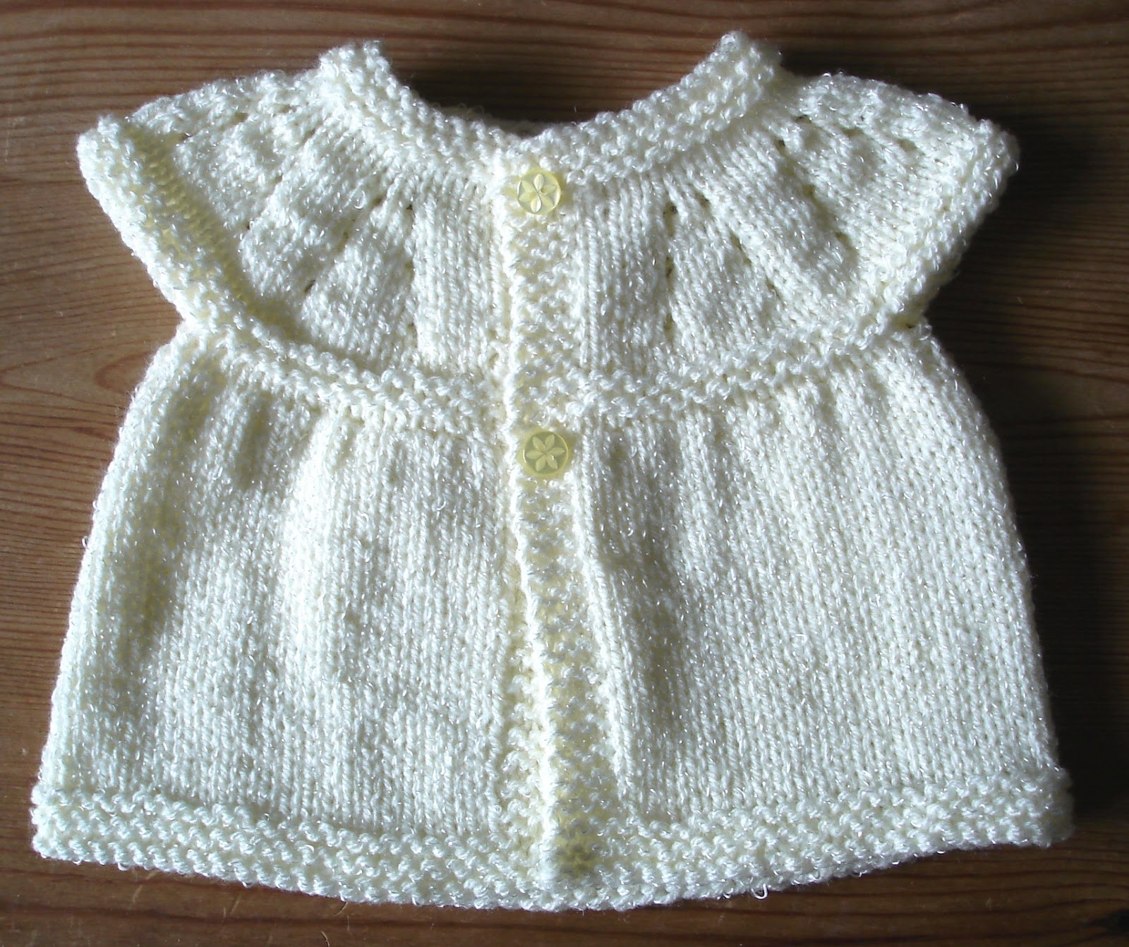 Knitting Designs For Newborn Babies : Marianna s lazy daisy days all in one knitted baby tops