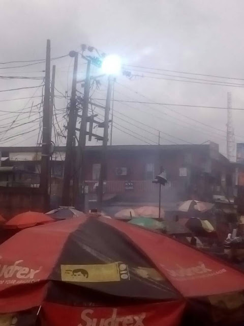 Chaos as PHCN electric pole sparks at a roundabout in Lagos