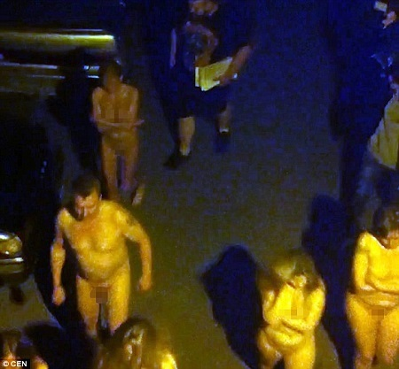 11 Prostitutes and their Customers Forced by Police to Walk Stark N*ked Through Streets (Video)