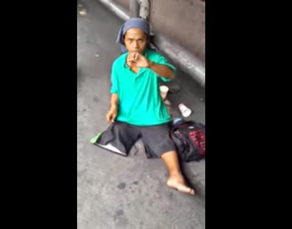 The beggars tried to cover his face after the confrontation.