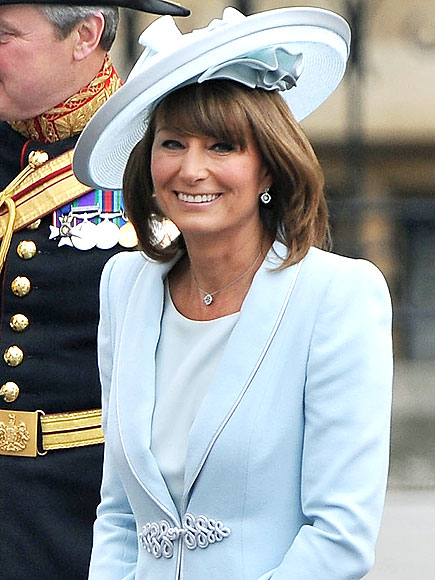 The mother of the bride adds something blue in her sky blue silk dress and  matching passementerie coat by Catherine Walker (one of Princess Diana s ... e556a4549f1