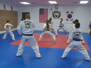 Students at the Colorado Taekwondo Institute working out with Caela McCartney