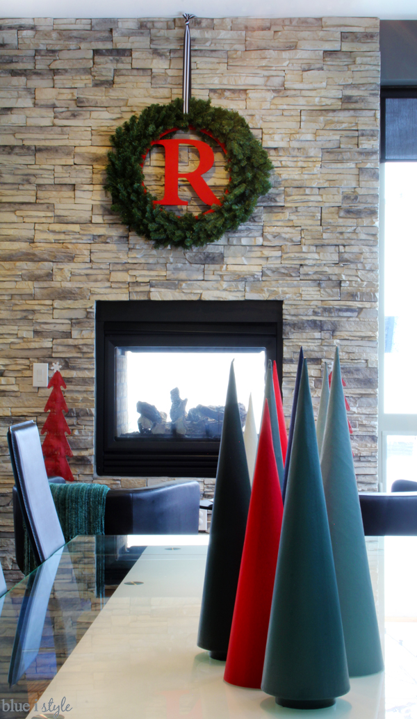 Monogram Christmas Wreath on stone fireplace