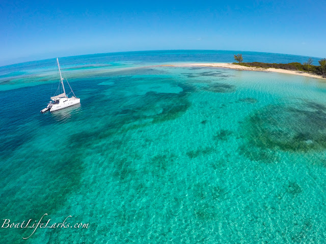 Drone shot: Lagoon 380 sail catamaran at anchor, Honeymoon Harbor, Gun Cay, Bimini Islands, Bahamas