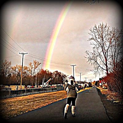 M.W. Bychowski with child under rainbow