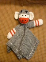 http://www.ravelry.com/patterns/library/sock-monkey-lovie