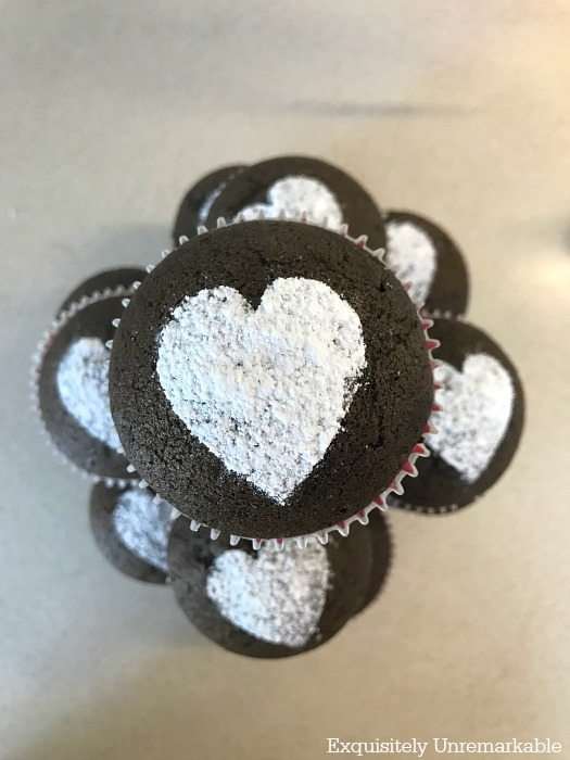 Easy Vegan Chocolate Cupcakes with powdered sugar hearts in a pyramid