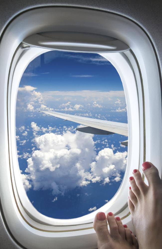 Flight attendants don't want to see your bare feet on the windows.