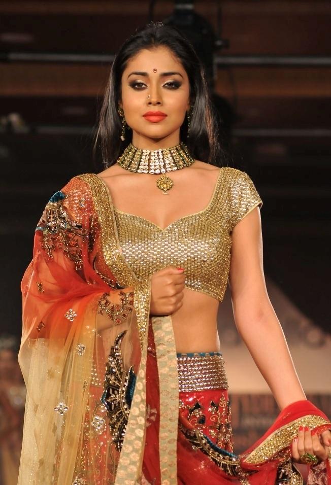 Shriya Saran At International Fashion Week In Orange Dress